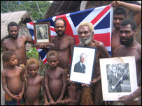 Island of Tanna in Vanuatu - tribe hold up pictures of Prince Phillip