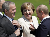 George Bush (left), Angele Merkel and Vladimir Putin laugh at the summit