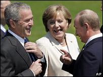 George Bush (left), Angele Merkel and Vladimir Putin laugh at the summit