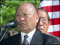 This file 11 May 2000 file photo shows former Hmong general Vang Pao with Lao veterans