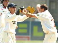 Glamorgan's Mark Wallace and Dean Cosker celebrate the wicket of Stephen Fleming  in the second innings