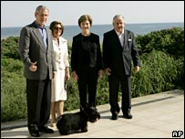 President Bush (l) and First Lady Laura Bush (second r) walk with Polish President Lech Kaczynski (r), his wife and their dog