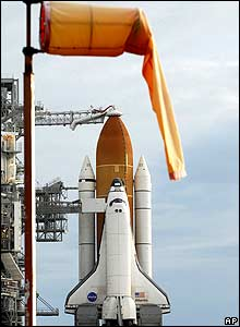 A weather sock indicating light winds is seen near the Space Shuttle Atlantis