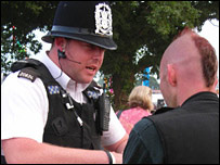 Police talking to festivalgoer
