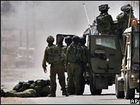 Israeli soldiers take up position near Kissufim after Palestinian attack