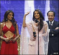 Aishwarya Rai (C) acknowledges the audience