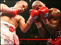 Miguel Cotto lands an uppercut on Zab Judah.
