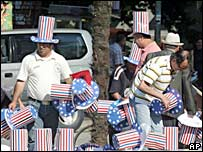 Albanians wear Uncle Sam hats to greet President Bush
