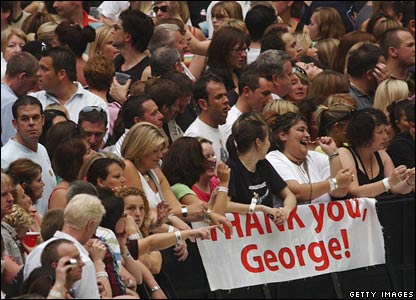 "Fans with poster saying ""Thanks George"""