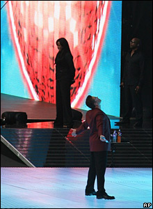 George Michael in front of heart backdrop