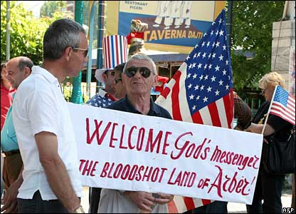 Albanians with a poster wait to greet President Bush