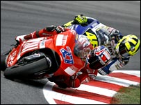 Stoner holds off Rossi in Barcelona.