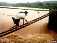 A man climbs a floodgate in Zijin county, in China's Guangdong Province. 09/06/07