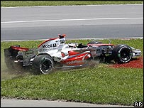 Fernando Alonso runs across the grass on the first lap in Canada