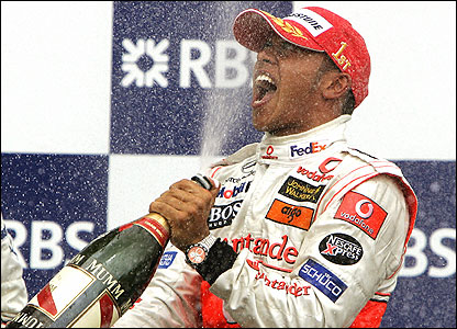 Lewis Hamilton celebrates with champagne after the presentation ceremony