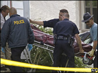 Police officers carry out the body of one of those shot in Delavan, Wisconsin, US