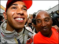 Lewis Hamilton celebrates his maiden Grand Prix victory with his father Anthony