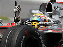 Lewis Hamilton waves after winning his maiden Grand Prix