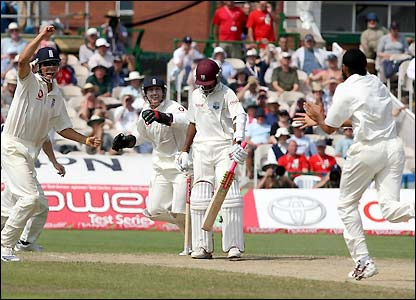 England's celebrate the early scalp of Ramdin