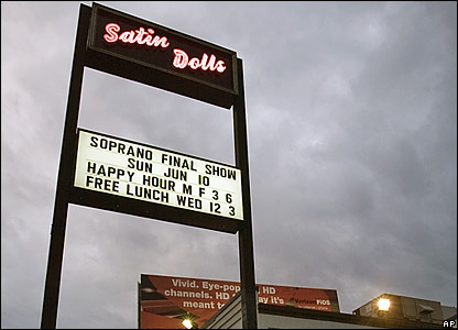 A sign outside the Satin Dolls nightclub