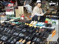 Chinese worker making shoes