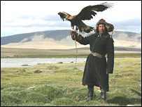 Mongolian man with bird of prey