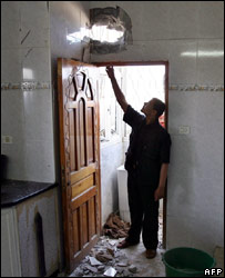 Ismail Haniya's son points at damage at their family house following an attack on 12 June 2007