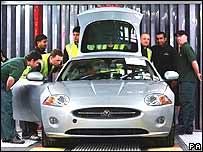 Jaguar workers looking at the new XK model