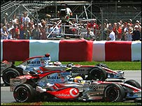 Lewis Hamilton passes Fernando Alonso after the Spaniard makes a mistake at the start of the Canadian Grand Prix
