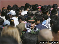 A policeman stands amid crowds in Beijing (file image)