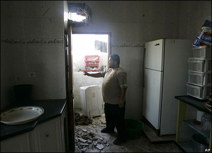 A Palestinian man inspects the damage to Prime Minister Ismail Haniya's home