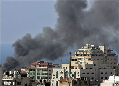 Smoke rises in the Shati refugee camp in Gaza City