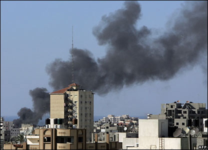 Smoke bellows from a building in Gaza City