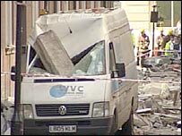Van hit by debris in London building collapse