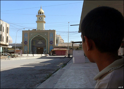 A boy looks at the remains of the mosque