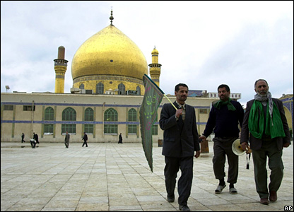 Pilgrims walk in front of the famous shrine in Samarra in February 2004