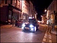 Car being driven at night