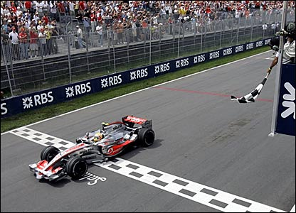 Lewis Hamilton takes the chequered flag in Canada