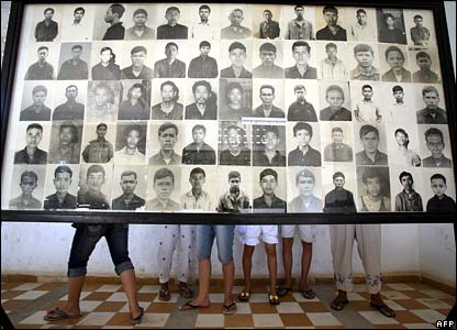 Cambodians look at pictures of victims of the Khmer Rouge