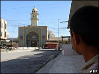 A boy surveys the damage to the shrine, Wednesday 13 June 2007