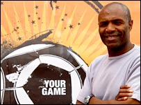 Luther Blissett poses with the Your Game logo