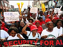 Striking South African public workers demonstrating