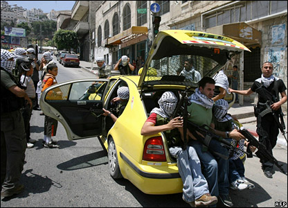 Militants from the Fatah-linked al-Aqsa Martyrs' Brigades get into a car in Nablus