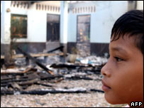 Boy surveys a Thai school that has been set ablaze 06/06/2007
