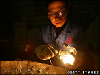 Worker in a light bulb factory