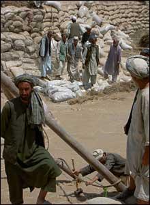 Villagers building a dam
