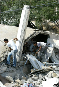 Palestinian youth climb on the debris of the destroyed base belonging to the Palestinian security forces loyal to President Mahmoud Abbas