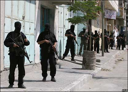 Hamas militants deploy close to the pro-Fatah Preventive Security headquarters for the whole of the Gaza Strip