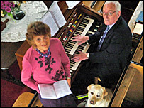Teddy with his carer Nona Rees and chapel organist Jim Jones