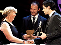 Last year's Unsung Hero winner, Val Hanover, receives her award from Alan Shearer and Owen Hargreaves